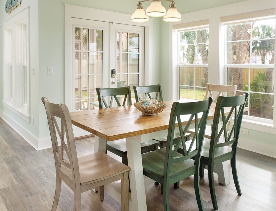 The dining room offers plenty of natural light at our farmhouse-style table.